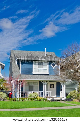 Suburban middle  class home with nicely landscaped front yard lawn - stock photo