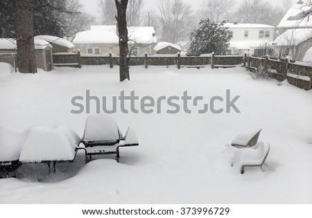 Suburban Neighborhood Backyard Blizzard - Deep Snow - stock photo