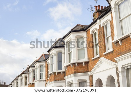 Suburban Neighborhood Houses in a winter sunny day in West London, United Kingdom. - stock photo