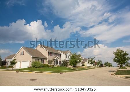 Suburban neighborhood in the summer. - stock photo