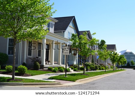 Suburban neighborhood new england style american stock for New american homes