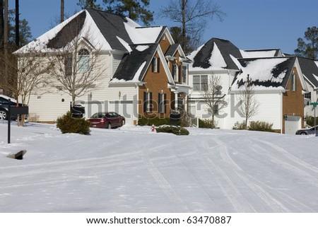 Suburban neighborhood street in winter - stock photo