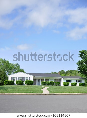 Suburban one story Ranch style Home in Residential Neighborhood Beautiful Sunny Blue Sky Day with clouds - stock photo