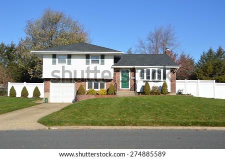 Suburban Ranch home sunny clear blue sky residential neighborhood USA - stock photo