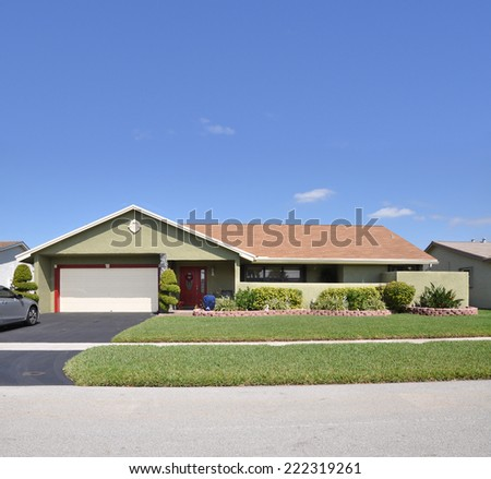 Suburban ranch style home residential neighborhood blue sky USA - stock photo