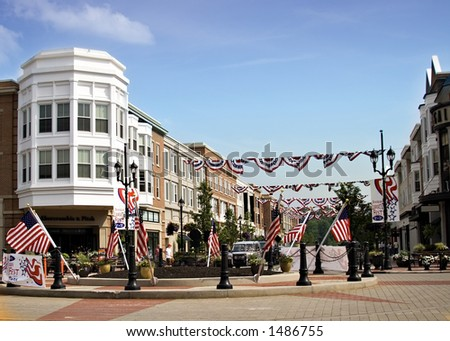 Suburban residential and commercial area decorated for the fourth 4th of July.  Banners and flags displayed. - stock photo