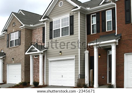 Suburban townhomes under construction. - stock photo