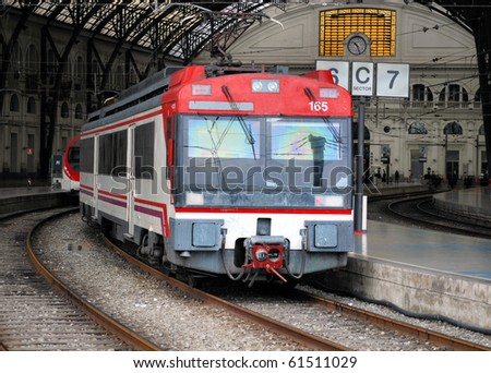 suburban train at railway station in barcelona - stock photo