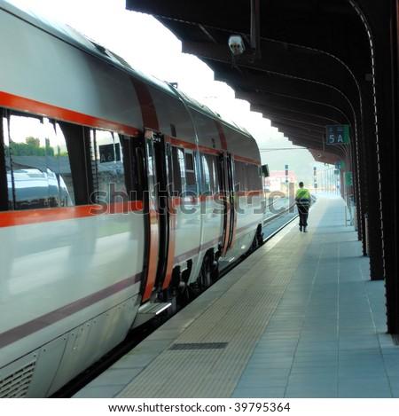 suburban train car at station and the policeman - stock photo