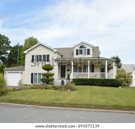 Suburban Two Story Home blue sky clouds USA