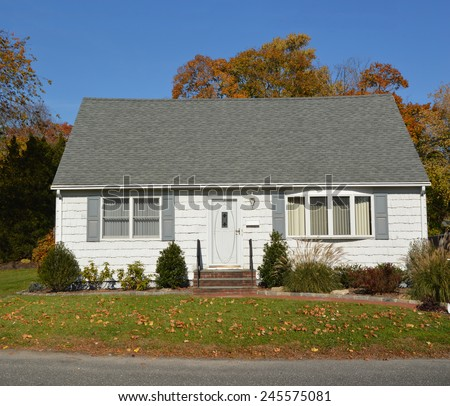 suburban white and gray cape cod style home autumn day sunny clear blue sky residential neighborhood - Cape Cod Style House Colors
