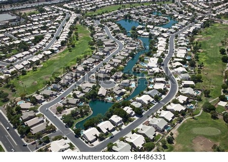 Suburbia with Swimming Pools on man made lake - stock photo