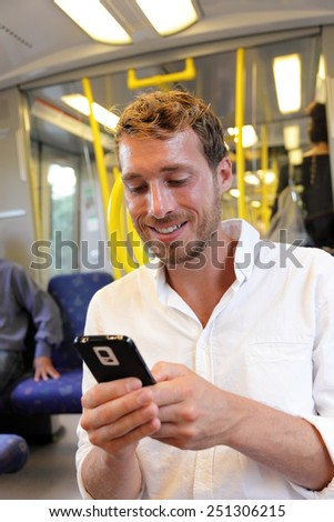 Subway businessman texting sms using smartphone apps. Casual man reading emails or news on smart phone online by 3g or 4g with wifi on swedish subway or outdoor train in Stockholm, Sweden. - stock photo