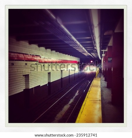 Subway car arriving underground in the New York City subway station with Instagram effect filter. - stock photo
