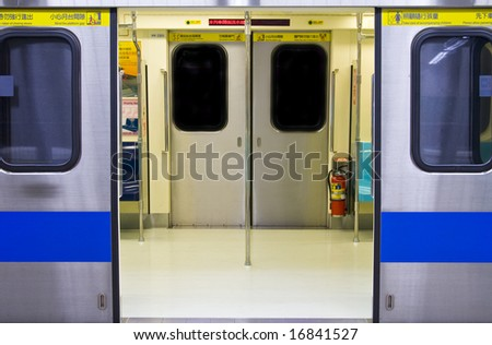 Subway carriage empty with doors open in China - stock photo