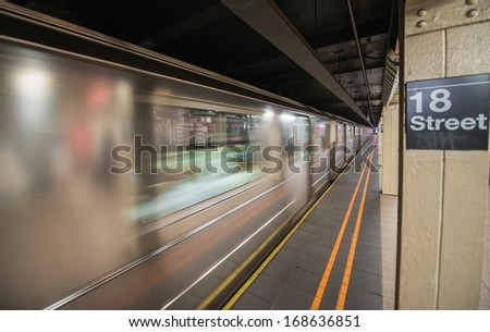 Subway in New York City. 18 st station with speeding up train. - stock photo