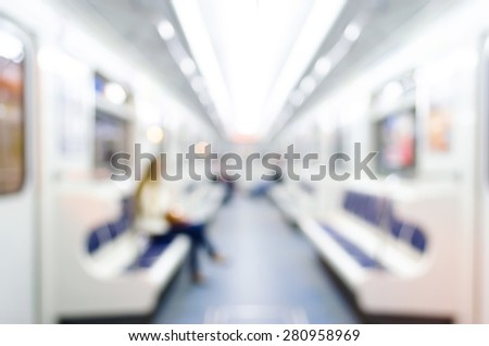 Subway passengers are people, wagon, train lights, interior, seats - stock photo