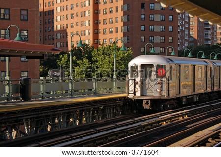 Subway Train Approaching 125th St. - stock photo