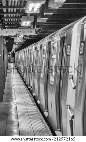 Subway train awaiting departure in Manhattan station - New York City. - stock photo