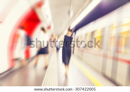subway train passing by with passangers waiting,speed motion blur background