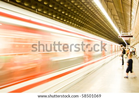 Subway train pulling into the station. Motion blur picture. color version. - stock photo