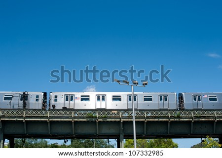 Subway train running outdoors in New York City. - stock photo