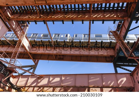 Subway train running outdoors on flyover in New York City.  - stock photo