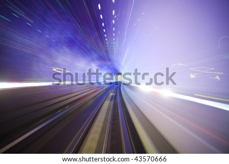 subway train speeding through a tunnel shanghai china. - stock photo