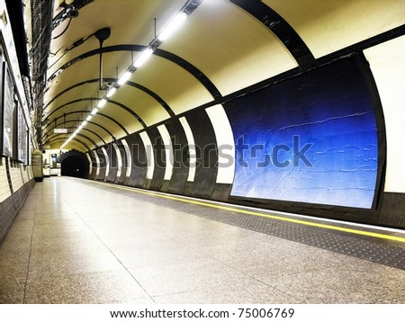 subway tube underground platform station in London - stock photo