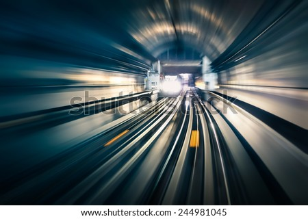 Subway tunnel with blurred light tracks with arriving train in the opposite direction - Concept of modern metro underground transport and connection speed - stock photo