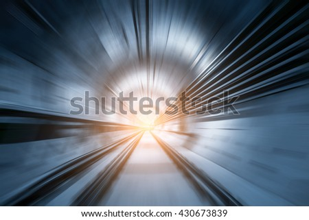 Subway tunnel with blurred light tracks with arriving train in the opposite direction - Concept of modern metro underground transport and connection speed