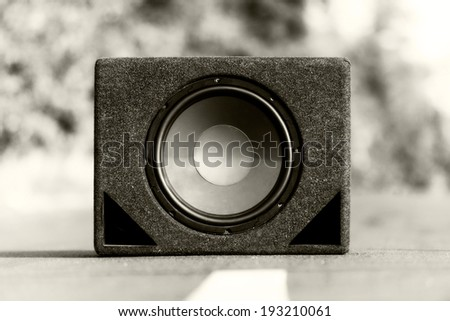 Subwoofers on the road outdoors closeup photo - stock photo