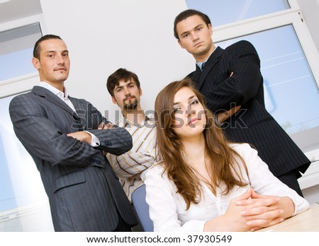 Suc?essful business team, focus on woman - stock photo