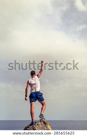 Success achievement running or hiking accomplishment business concept with man celebrating with arms up raised outstretched trekking trail running outdoors. Inspiration motivation, healthy lifestyle. - stock photo