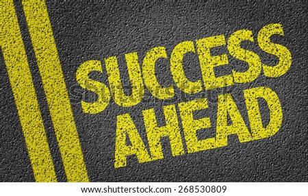 Success Ahead written on the road - stock photo
