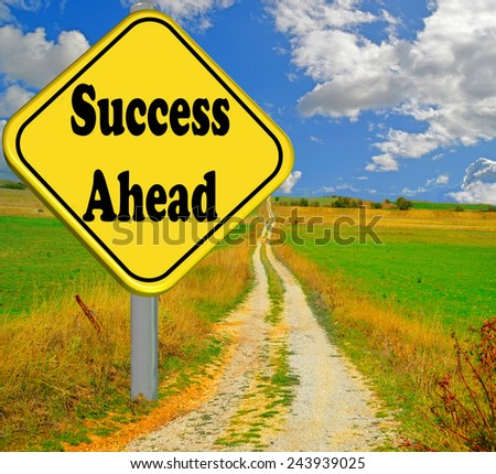 success ahead yellow road sign - stock photo