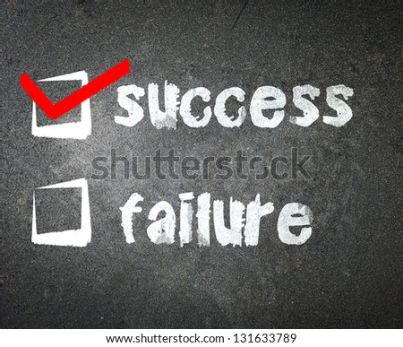 Success and failure handwritten with white chalk on a blackboard with check box - stock photo