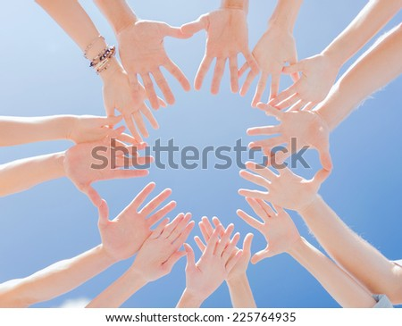 success and gesture concept - close up of circle of hands - stock photo