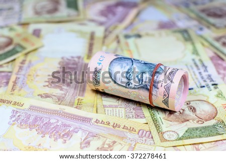 Success and got profit from business with 500 and 1000 banknotes of indian rupee currency,money,Focus on eye of Gandhi - stock photo