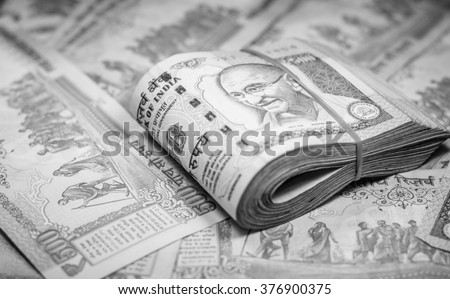 Success and got profit from business with 500 banknotes of indian rupee currency,money on black and white color,Focus on eye of Gandhi - stock photo