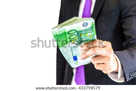 Success and got profit from business with businessman holding Euro currency,money in a hand isolated on white background,Focus on number 100 of banknote - stock photo