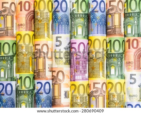 Success and got profit from business with colorful roll of Euro currency,money banknotes - stock photo