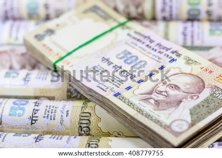 Success and got profit from business with indian rupee currency,money,Focus on eye of Gandhi - stock photo