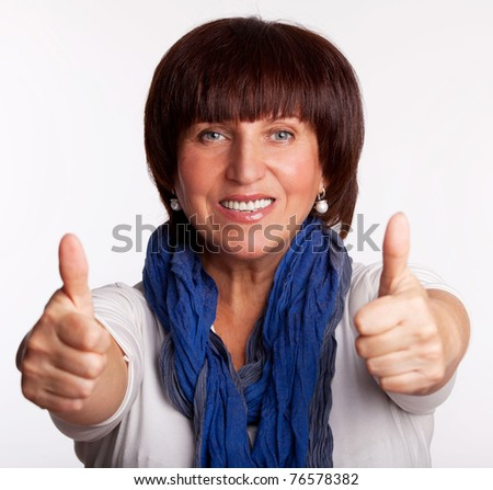 Success and happy mid adult woman - stock photo
