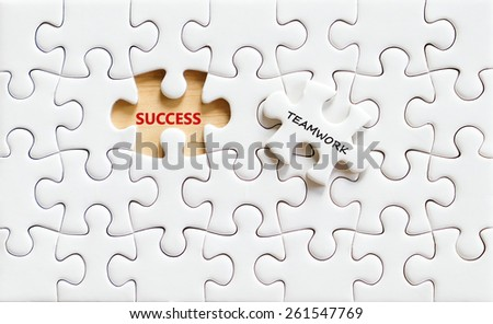 Success and teamwork words on white jigsaw puzzle background, success in business concept - stock photo