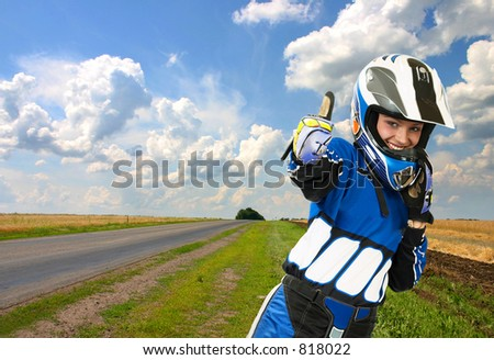 Success and victory!!! Attractive sexy woman in motoracer uniform. - stock photo