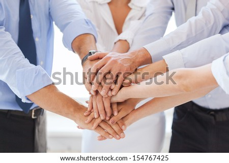 success and winning concept - happy business team celebrating victory in office - stock photo