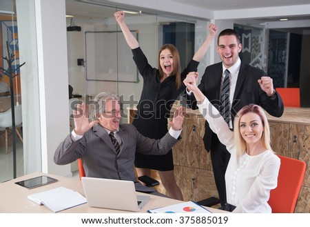 success and winning concept happy business team in office