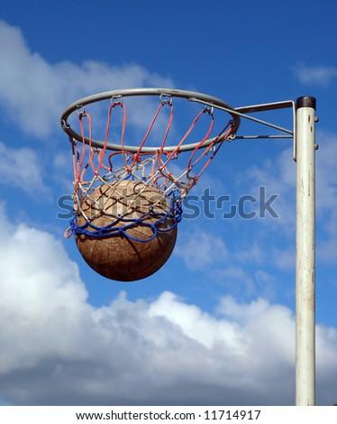 Success. Ball going through the net - stock photo
