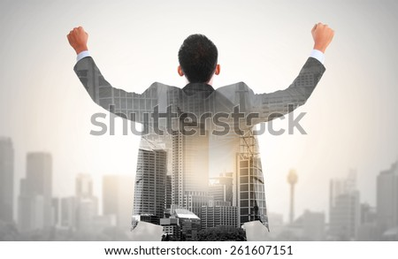 success business man raise his hand double exposure concept of businessman and city - stock photo